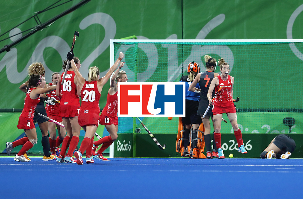 RIO DE JANEIRO, BRAZIL - AUGUST 19:  Great Britain players celebrate the third goal scored by Nicola White (not pictured) during the Women's Gold Medal Match against the Netherlands on Day 14 of the Rio 2016 Olympic Games at the Olympic Hockey Centre on August 19, 2016 in Rio de Janeiro, Brazil.  (Photo by David Rogers/Getty Images)