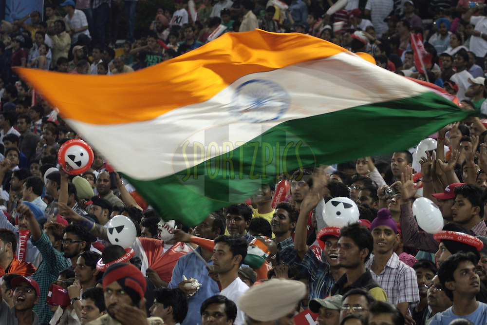 Fans with Indian Flag during match 54 of the Indian Premier League ( IPL ) Season 4 between the Kings XI Punjab and the Mumbai Indians held at the PCA stadium in Mohali, Chandigarh, India on the 10th May 2011..Photo by Anil Dayal/BCCI/SPORTZPICS