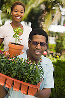 Couple Holding New Plants