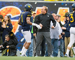 Nov 28, 2015; Morgantown, WV, USA; West Virginia Mountaineers wide receiver Shelton Gibson (1) celebrates with West Virginia Mountaineers head coach Dana Holgorsen after scoring a touchdown during the first quarter against the Iowa State Cyclones at Milan Puskar Stadium. Mandatory Credit: Ben Queen-USA TODAY Sports