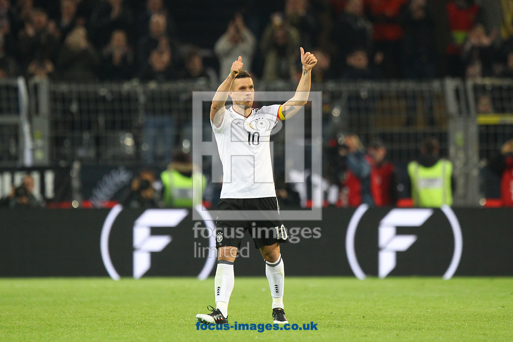 Lukas Podolski of Germany acknowledges the fans as he leaves the International field for the very last time during the International Friendly match at Signal Iduna Park, Dortmund<br /> Picture by Paul Chesterton/Focus Images Ltd +44 7904 640267<br /> 22/03/2017