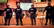 Outside the Westin Hotel last night, police watch demonstrators who are blocking the doors, demanding the release of jailed protesters, among other things. The sign is on the Icon Grill.<br /> <br /> WORLD TRADE ORGANIZATION; WTO<br /> <br /> OUTSIDE THE WESTIN HOTEL ON FRIDAY NIGHT, POLICE WATCH DEMONSTRATORS BLOCKING THE DOORS OF THE HOTEL AND DEMANDING THE RELEASE OF JAILED PROTESTERS, AMONG OTHER THINGS.