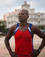 Cuban runner practicing near monument to Maximo Gomez, Havana, Cuba