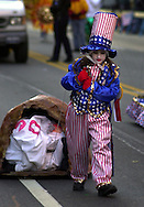 A young girl from the HOG Island Fancy Brigade, dressed in patriotic garb, participates in the 101st Mummers Parade, on New Years Day, Jan. 1, 2002, in Philadelphia. (Photo by William Thomas Cain/photodx.com)