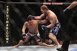 January 1, 2011; Las Vegas, NV; USA; UFC Lightweight Champion Frankie Edgar ( trunks) and challenger Gray Maynard ( trunks) fight during their UFC Lightweight championship bout at UFC 125 at the MGM Grand Garden Arena in Las Vegas.  After 5 rounds the bout ended in a draw.