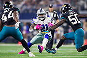 ARLINGTON, TX - OCTOBER 14:  Ezekiel Elliott #21 of the Dallas Cowboys runs the ball during a game against the Jacksonville Jaguars at AT&T Stadium on October 14, 2018 in Arlington, Texas.  The Cowboys defeated the Jaguars 40-7.  (Photo by Wesley Hitt/Getty Images) *** Local Caption *** Ezekiel Elliott