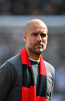 Football - 2018 / 2019 Premier League - Fulham vs. Manchester City<br /> <br /> Manchester City manager Pep Guardiola comes out onto the pitch, at Craven Cottage.<br /> <br /> COLORSPORT/ASHLEY WESTERN