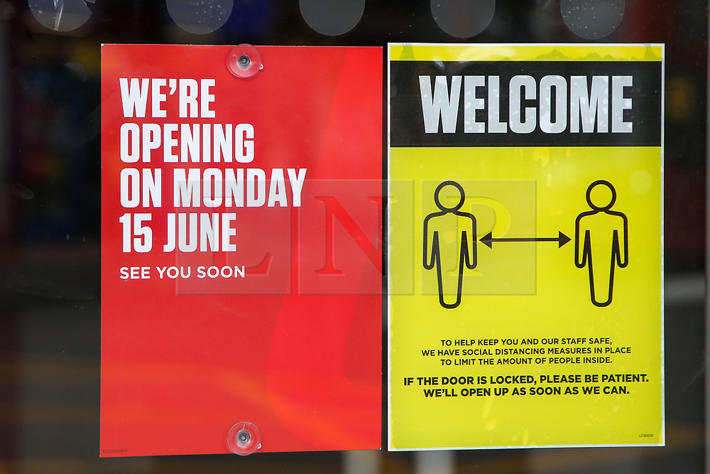 """© Licensed to London News Pictures. 14/06/2020. London, UK. 'WE""""RE OPENING ON MONDAY 15 JUNE' and a """"WELCOME' sign on the window of Ladbrokes in north London, which will reopen on 15 June as coronavirus lockdown restrictions are eased. The government has announced that all betting shops can re-open on Monday 15 June. Betting shops were closed late March following outbreak of COVID-19. Photo credit: Dinendra Haria/LNP"""