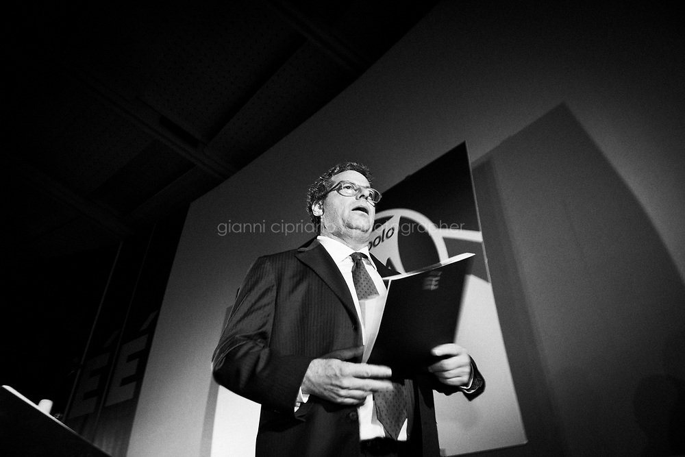 "Palermo, Italy, 25 October 2012: Canidate for Governor of Sicily Gianfranco Micciché, 58, steps down from the stage after rallying at his electoral committee  in Palermo, on October 25 2012. His motto is ""Sugnu Sicilianu - Sogno Siciliano"", which translates as ""I am Sicilian"" in the Sicilian dialect and ""Sicilian dream"". His is allied with the MpA (Movimento per le Autonomie, Movement for Autonomies), a regionalist and Christian democratic party which demands greater autonomy for Sicily. The movement was founded my former Governor of Sicily Raffaele Lombardo, who resigned in July. Gianfranco Micciché is endorsed by President of the Chamber of Deputies and leader of the Future and Freedom party Gianfranco Fini.<br /> <br /> The direct elections in Sicily for the President of the Region and its representatives will take place on Sunday 28 October 2012, 6 months ahead of the end of the terms of office of the current legislature. The anticipated election of October 28 take place after Raffaele Lombardo, former governor of Sicily since 2008, resigned on July 31st. Raffaele Lombardo is under investigation since 2010 for Mafia ties. His son Toti Lombardo is currently running for a seat in the Sicilian Regional Assembly in the coalition of Gianfranco Micciché, a candidate for the Presidency of the Region. 32 candidates belonging to 8 of the 20 parties running for the Sicilian elections are either under investigation or condemned. ### Palermo, Italia, 25 ottobre 2012: il candidato alla Presidenza della Regione Gianfranco Micciché, 58 anni, scende dal palco dopo un comizio nel suo comitato elettorale a Palermo il 25 ottobre 2012. Il suo slogan è ""Sugnu Siciliano - Sono Siciliano"" (""Sono siciliano in dialetto). Si è alleato con l'Mpa (Movimento per le Autonomie), fondato da Raffaele Lombardo, il quale ha rassegnato le dimissioni a luglio. Gianfranco Micciché è appoggiato dal Presidente della Camera dei Deputati e leader di Futuro e Libertà Gianfranco FIni.<br /> <br /> Le elezioni in Sicilia"