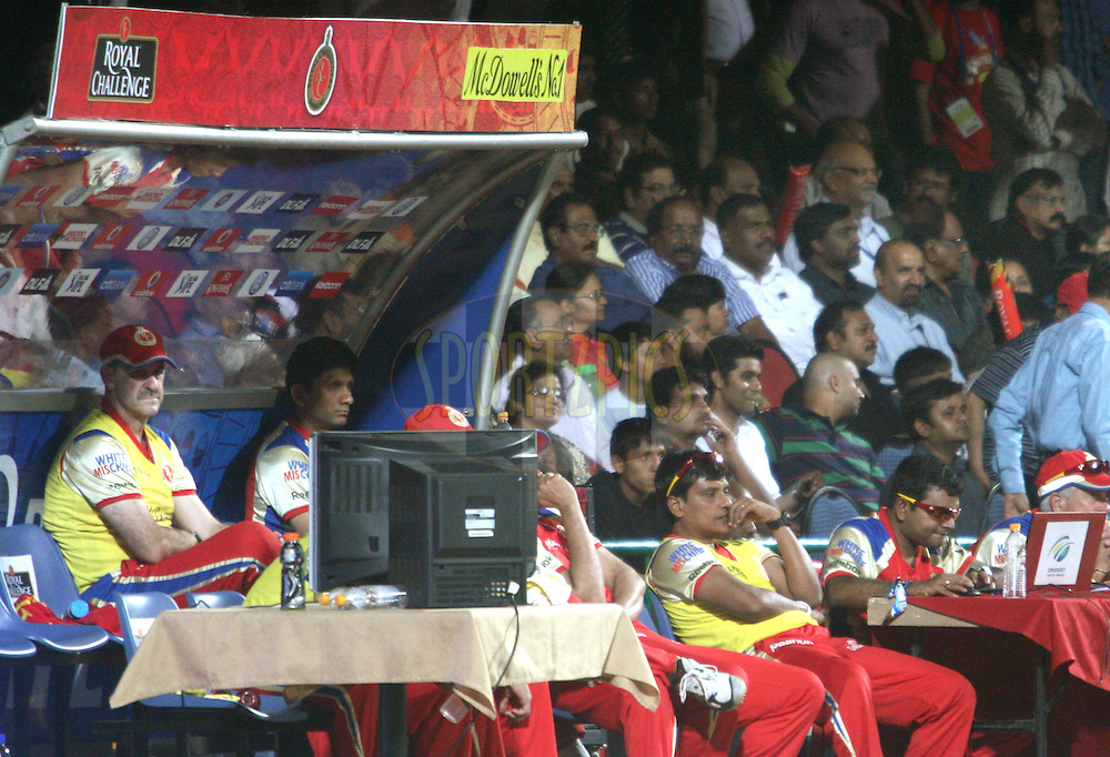 RCB's support staff seen in their dugout during match 8 of the the Indian Premier League ( IPL ) Season 4 between the Royal Challengers Bangalore and the Mumbai Indians held at the Chinnaswamy Stadium, Bangalore, Karnataka, India on the 12th April 2011..Photo by Vino John/BCCI/SPORTZPICS