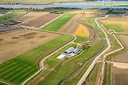 Nederland, Noord-Brabant, Werkendam, 23-10-2013; Ruimte voor de Rivier project Ontpoldering Noordwaard, rivier de Nieuwe Merwede aam de horizon. Boerderijen en particuliere huizen worden op nieuw opgeworpen terpen gebouwd. Geheel rechts een nieuwe dijk.<br /> Voor dit project worden delen van de polder ontpolderd en de dijken worden verlegd en/of verlaagd waardoor bij hoogwater het rivierwater ook door de polder sneller weg kan stromen richting zee. Gevolg van de ingrepen is ook dat de waterstand verder stroomopwaarts zal dalen.<br /> <br /> QQQ<br /> luchtfoto (toeslag op standard tarieven);<br /> aerial photo (additional fee required);<br /> copyright foto/photo Siebe Swart