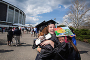 Hannah Shull gets a hug from her friends Courtney Phelps and Suzy Goralske following the Ohio University Commencement ceremony Saturday May 3, 2014..  Photo by Ohio University / Jonathan Adams