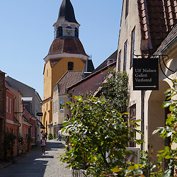 The belfry is part of Faaborg´s original parish church - St. Nicolai. The church was founded in about 1250 while the belfry is built towards the end of the 1400.