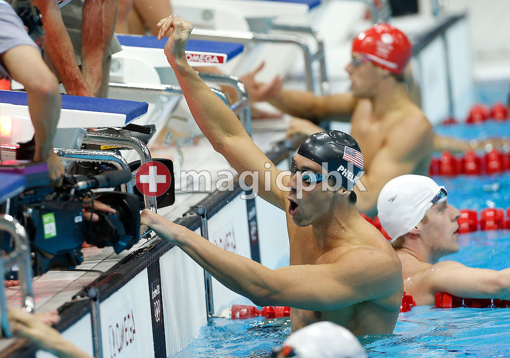 Michael Phelps of the USA celebrates after touching first in the men's 4x200m Freestyle Relay Final during the Swimming competition held at the Aquatics Center during the London 2012 Olympic Games in London, Great Britain, Tuesday, July 31, 2012. This is Phelps 19th Olympic medal which makes him the most decorated Olympian of all time. (Photo by Patrick B. Kraemer / MAGICPBK)