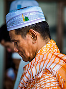 25 JUNE 2017 - BANGKOK, THAILAND: A man prays during Eid al-Fitr services at Bang Luang Mosque. Eid al-Fitr is also called Feast of Breaking the Fast, the Sugar Feast, Bayram (Bajram), the Sweet Festival or Hari Raya Puasa and the Lesser Eid. It is an important Muslim religious holiday that marks the end of Ramadan, the Islamic holy month of fasting. Muslims are not allowed to fast on Eid. The holiday celebrates the conclusion of the 29 or 30 days of dawn-to-sunset fasting Muslims do during the month of Ramadan. Islam is the second largest religion in Thailand. Government sources say about 5% of Thais are Muslim, many in the Muslim community say the number is closer to 10%.    PHOTO BY JACK KURTZ