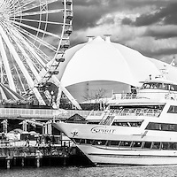 Chicago Navy Pier black and white panoramic picture with the Ferris Wheel and Spirit boat. Panorama raito is 1:3.  Image Copyright © Paul Velgos All Rights Reserved.