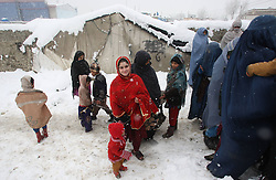61023454<br /> Afghan refugees wait to receive winter relief supplies donated by German government at a refugee camp during snowfall in Kabul, Afghanistan, on Feb. 6, 2014. Around 146 refugee families received winter relief supplies on Thursday, Afghanistan. Thursday, 6th February 2014. Picture by  imago / i-Images<br /> UK ONLY