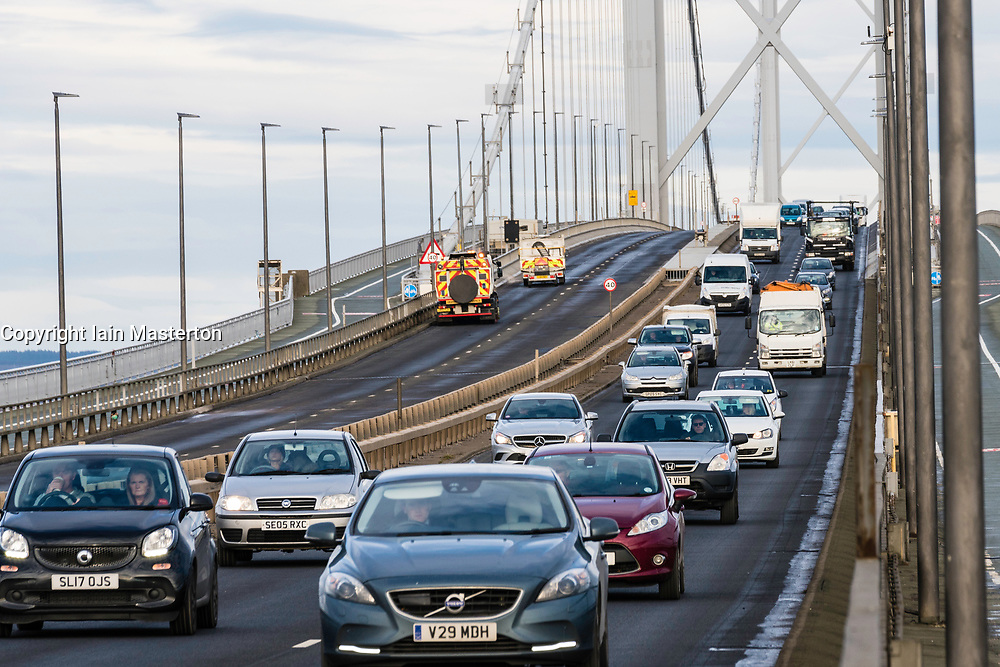 Southbound carriageway of new Queensferry Bridge is closed to allow emergency repairs to the carriageway. Southbound traffic from Fife is being diverted over the adjacent Forth Road Bridge, shown here, which has been opened temporarily to traffic. Remedial snagging work to the Queensferry Bridge is expected to take 10 months.