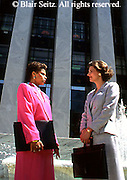 female, executives, managers, lawyers at courthouse