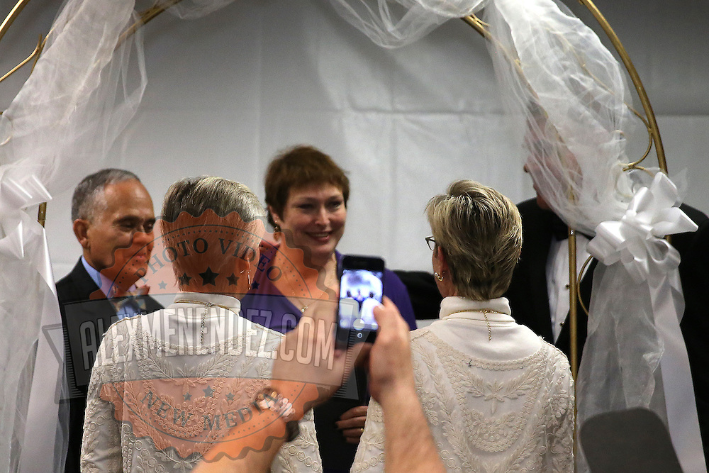 Osceola County Commisioner Cheryl Grieb, left, and partner Patti Daugherty, give their vows during Osceola County Florida's first gay marriage which started just after midnight on January 6, 2015 at the Osceola County courthouse in Kissimmee, Florida.  (AP Photo/Alex Menendez)