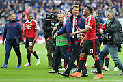 Manchester United Manager Louis van Gaal smiles with Anthony Martial of Manchester United after the whistle during the The FA Cup semi final match between Everton and Manchester United at Wembley Stadium, London, England on 23 April 2016. Photo by Phil Duncan.