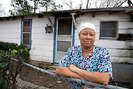 Indianola, Mississippi, February, 2009. A woman in front of her house next to BB Kings Club Ebony. Indianola is home of the Delta blues tradition that started in the cotton field and the Juke joints by the black sharecroppers. Photo by Frits Meyst/Adventure4ever.com