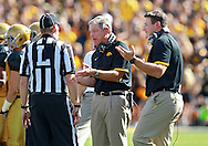 September 08 2012: Iowa Hawkeyes head coach Kirk Ferentz and offensive line coach Brian Ferentz argue their case to the official during the second quarter of the NCAA football game between the Iowa State Cyclones and the Iowa Hawkeyes at Kinnick Stadium in Iowa City, Iowa on Saturday September 8, 2012. Iowa State defeated Iowa 9-6.