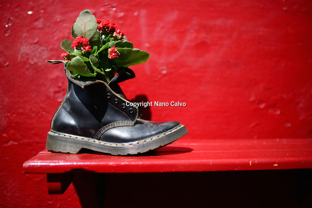 Flowers in boot outside a restaurant in The Albaicin Quarter, old Moorish quarter across the River Darro from the Alhambra, Granada, Spain