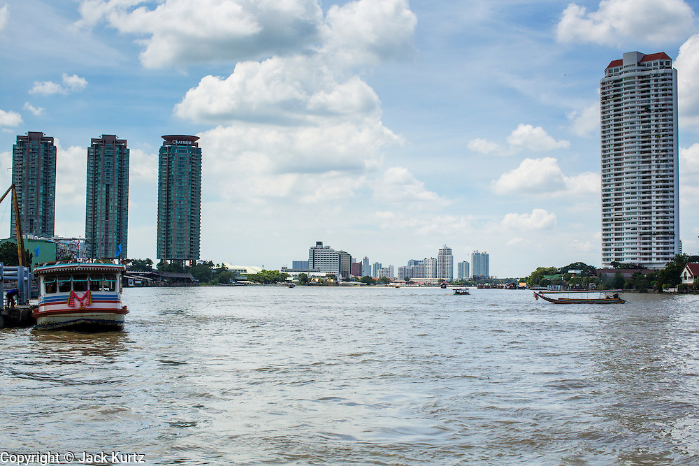 05 OCTOBER 2012 - BANGKOK, THAILAND:   Residential condominium towers on the banks of the Chao Phraya River in Bangkok, Thailand. The Chao Phraya cuts Bangkok in half. Thonburi, the oldest part of the city, is on the west bank (right in photo) and the newer Bangkok is on the east side (left in photo).     PHOTO BY JACK KURTZ