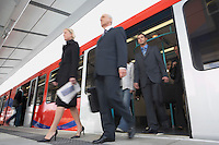 Business Commuters Getting off a Train motion blur low angle view