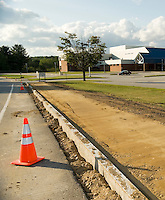 Construction is underway on the second phase of the sidewalk instrumented by a group of graduating Gilford High School students who originally began the project during their middle school years in Linda Wright's family consumer science class.  (Karen Bobotas/for the Laconia Daily Sun)