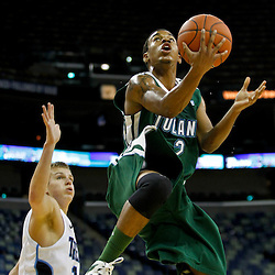 November 27, 2011; New Orleans, LA; Tulane Green Wave guard Ricky Tarrant (2) shoots past San Diego Toreros guard Johnny Dee (1) during the first half of Hoops for Hope Classic at the New Orleans Arena.  Mandatory Credit: Derick E. Hingle-US PRESSWIRE