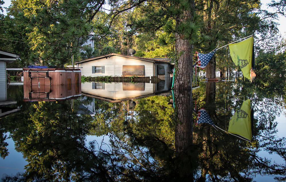 Flooded home with a Confederate flag in Socastee, South Carolina following Hurricane Florence.