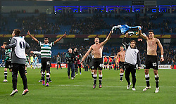 MANCHESTER, ENGLAND - Thursday, March 15, 2012: Sporting Clube de Portugal's Renato Neto, Emiliano Insua and Xandao celebrate their side's 3-2 defeat to Manchester City, meaning that they are through to the next round, after the UEFA Europa League Round of 16 2nd Leg match at City of Manchester Stadium. (Pic by Vegard Grott/Propaganda)