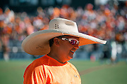 """SHOT 8/16/14 5:16:43 PM - Denver Outlaws lacrosse fan Karl Engelmann of Denver, Co. used a wide brimmed cowboy hat to escape the sun during the """"Orangeout"""" at the MLL Semifinals matchup against the New York Lizards at Peter Barton Lacrosse Stadium on the University of Denver campus in Denver, Co. Saturday. The Denver Outlaws won the game 14-13 to advance. Temps on the field were measured at 116 degrees that day. (Photo by Marc Piscotty / © 2014)"""