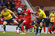 Jay Simpson is sandwiched by John Lundstram and Joe Skarz during the Sky Bet League 2 match between Leyton Orient and Oxford United at the Matchroom Stadium, London, England on 17 October 2015. Photo by Bennett Dean.