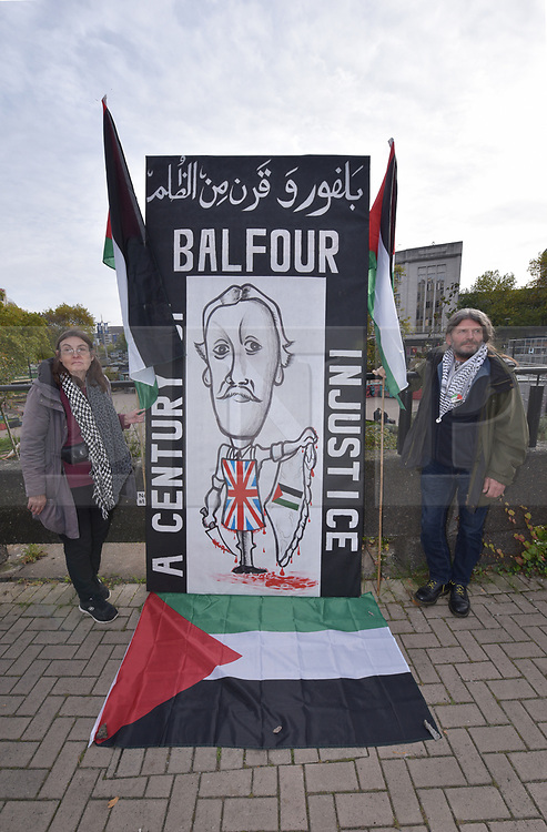 "© Licensed to London News Pictures.  01/11/2017; Bristol, UK. Bristol campaigners condemn the Balfour Declaration from 1917 on its centenary in 2007, unveiling a critical caricature depicting the then Foreign Secretary Arthur Balfour in a butchers apron weilding a knife on Palestine. The slogan, in both English and Arabic, reads 'BALFOUR - A CENTURY OF INJUSTICE.' The Balfour Declaration was a public statement issued by the British government during World War I announcing support for the establishment of a ""national home for the Jewish people"" in Palestine, then an Ottoman region with a minority Jewish population. The declaration was step to the creation of the state of Israel. Thursday 2nd November is the centenary of the Balfour Declaration. Palestine campaigners and radical street-artists will join forces in Bristol on 02 November to exhibit the statement of street-art condemning Balfour. The caricature is three metres high and one & half metres wide. Picture credit : Simon Chapman/LNP"