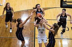 Emily Kiser shoots over double team during 2017, Girls Basketball NHS vs Northwestern., on 12, 21, 2017