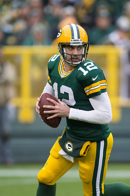 GREEN BAY, WI - DECEMBER 2:  Aaron Rodgers #12 of the Green Bay Packers drops back to pass against the Minnesota Vikings at Lambeau Field on December 2, 2012 in Green Bay, Wisconsin.  The Packers defeated the Vikings 23-14.  (Photo by Wesley Hitt/Getty Images) *** Local Caption *** Aaron Rodgers