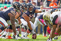 06 October 2013: Center (63) Roberto Garza of the Chicago Bears prepares to snap the ball against the New Orleans Saints during the second half of the Saints 26-18 victory over the Bears in an NFL Game at Soldier Field in Chicago, IL.