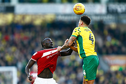 Famara Diedhiou of Bristol City battles for possession with Ben Godfrey of Norwich City - Mandatory by-line: Phil Chaplin/JMP - FOOTBALL - Carrow Road - Norwich, England - Norwich City v Bristol City - Sky Bet Championship