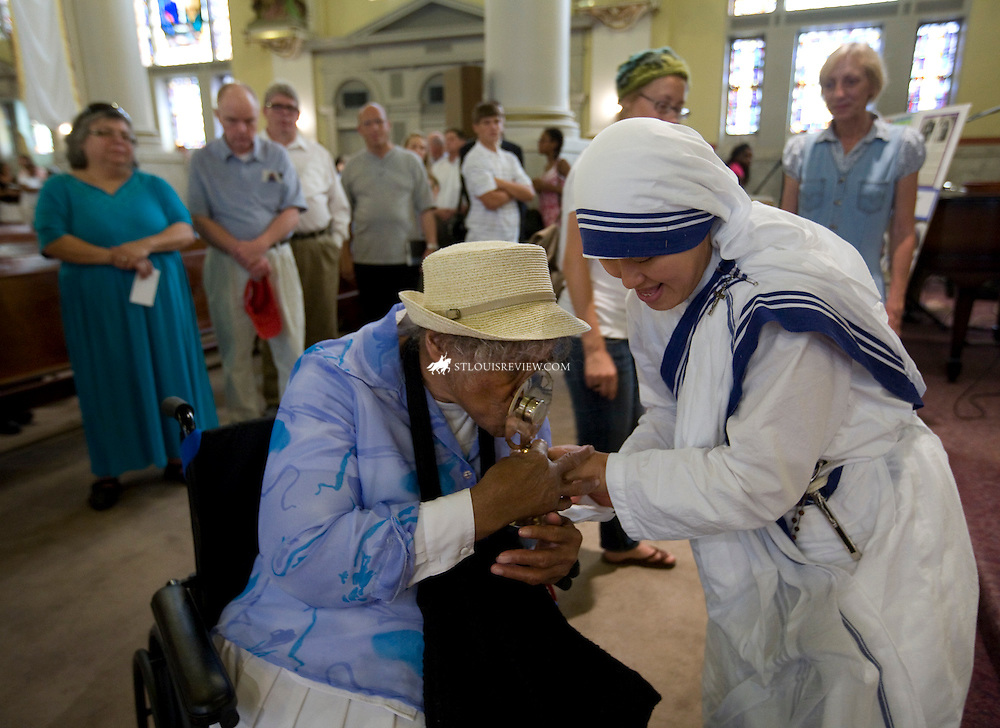 "Oralynn Allen, 84, kissed a relic of Blessed Teresa of Calcutta last week as it was held by a Missionaries of Charity nun at Sts. Teresa and Bridget Parish in North St. Louis. In 1978, Allen escorted Mother Teresa around St. Louis during a visit. ""We walked and walked all over St. Louis,"" Allen said. For one afternoon, the Missionaries of Charity placed on display relics of Blessed Teresa's blood and hair, as well as several items she used during her lifetime. The itiems included her sandals, a crucifix and rosary."