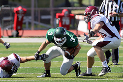 08 September 2012:  T.J. Stinde stumbles but stays on his feet after changing directions to avoid a defender during an NCAA division 3 football game between the Alma Scots and the Illinois Wesleyan Titans which the Titans won 53 - 7 in Tucci Stadium on Wilder Field, Bloomington IL