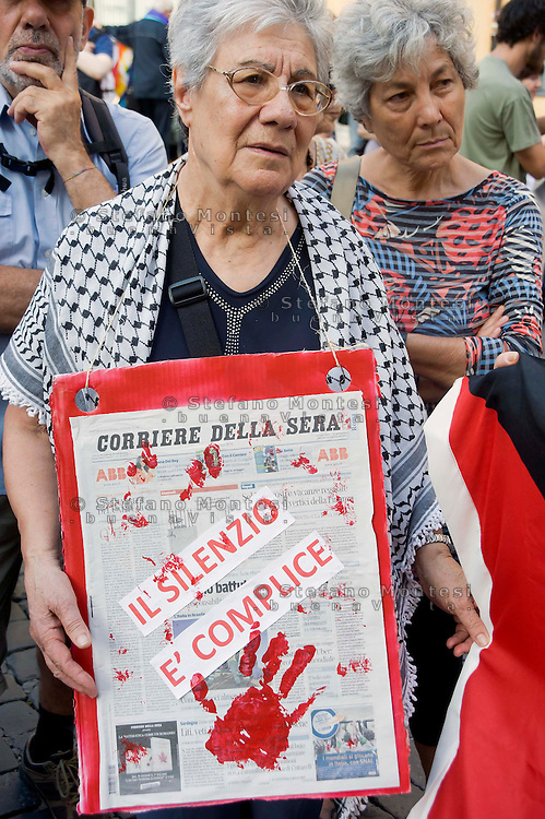 Roma 25 Giugno 2014<br /> Presidio davanti al Parlamento , per denunciare la situazione in Palestina, per il rispetto della legalit&agrave; internazionale e dei diritti umani nella Palestina occupata. I manifestanti  protestano anche  contro il governo e le forze armate israeliane che in seguito alla scomparsa di tre giovani coloni dalla zona C della Cisgiordania occupata (zona sotto il completo controllo militare dell&rsquo;esercito israeliano), ricorrono alla punizione collettiva di tutta la popolazione palestinese.I manifestanti protestano anche contro il silenzio dei giornali sulla situazione in Palestina.<br /> Rome June 25, 2014 <br /> Protest outside the Parliament, to denounce the situation in Palestine, for the respect of international law and human rights in occupied Palestine. I Demonstrators protest also against the government and the IDF that following the disappearance of three young settlers from the area C the occupied West Bank (the area under the complete control of the Israeli military), they resort to collective punishment of the entire Palestinian population. The demonstrators also protested against the silence of the newspapers on the situation in Palestine