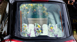 © Licensed to London News Pictures. 30/07/2018. Salisbury, UK. A hearse carrying the coffin, with the word MUM in flowers inside - arrives at Salisbury Crematorium for the funeral of Dawn Sturgess, who died on 8 July 2018 after exposure to the nerve agent Novichok. Special safety measures have been put in place to protect mourners attending the ceremony. Photo credit: Peter Macdiarmid/LNP