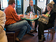 31 OCTOBER 2010 - WINDOW ROCK, AZ: John Wright, LEFT, Terry Goddard and Penny Kotterman Kotterman check their Blackberries during a break at the McDonald's in Window Rock. Goddard, and the other Democrats on the statewide ticket, campaigned in Window Rock and Kingman on Halloween. Goddard ended the day with a press conference in front of the Executive Office Tower at the State Capitol in Phoenix. Goddard lost the election to sitting Governor Jan Brewer, a conservative Republican.     PHOTO BY JACK KURTZ