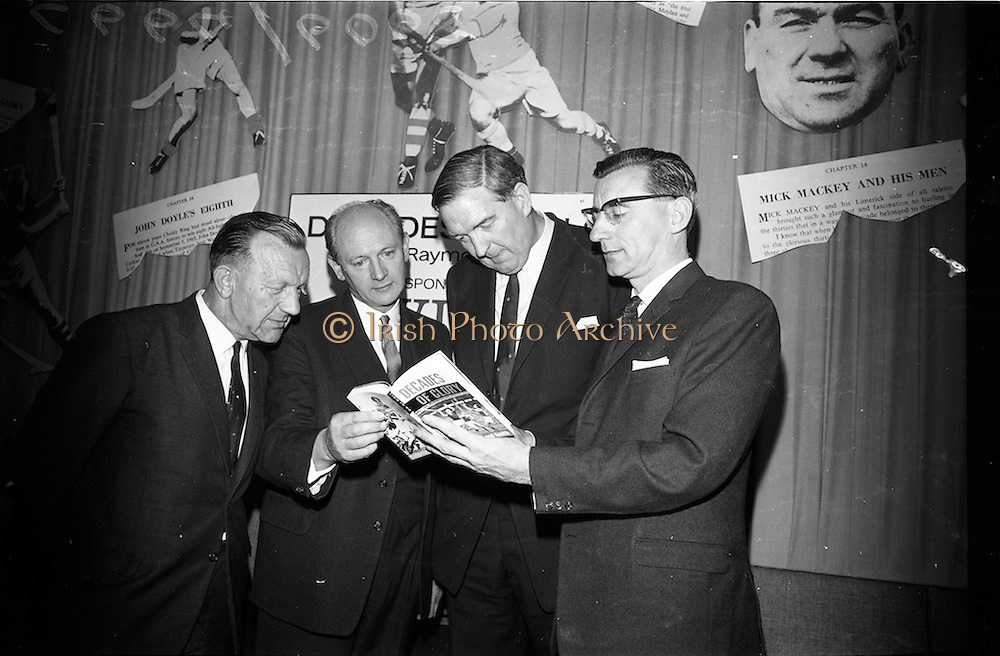 "17/05/1966<br /> 05/17/1966<br /> 17 May 1966<br /> Book reception for ""Decades of Glory: A Comprehensive History of the National Game"" by Raymond Smith.<br /> This reception was held in the offices of W.D. & H.O. Wills to honour the well known author and journalist, Raymond Smith. His book on the history of Hurling (""Decades of Glory"") has just been published with the assistance of Wills of Dublin and Cork and the Central Council of the G.A.A.<br /> Picture shows (from left to right): Seán Ó Síocháin (General Secretary of the G.A.A.), Mr. Jack Lynch (at the time he was Minister for Finance), Mr. D.R. Mott (Managing Director of Wills of Dublin and Cork), and Raymond Smith (author)."