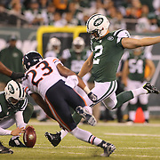 Nick Folk, New York Jets, kicks a field goal during the New York Jets Vs Chicago Bears, NFL regular season game at MetLife Stadium, East Rutherford, NJ, USA. 22nd September 2014. Photo Tim Clayton for the New York Times