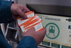 © under license to London News Pictures. 02/01/14. An average 2.8% increase in rail fares comes into effect on Thursday 2nd Jan 2014, pushing the cost of some commuter travel to more than £5,000 a year. FILE PICTURE DATED:  28/11/2012. A passenger buying train tickets from a ticket machine at Victoria Train Station. Rail fares set to increase by an average of 4.2% in January, a watchdog has revealed. Photo credit: Tolga Akmen/LNP