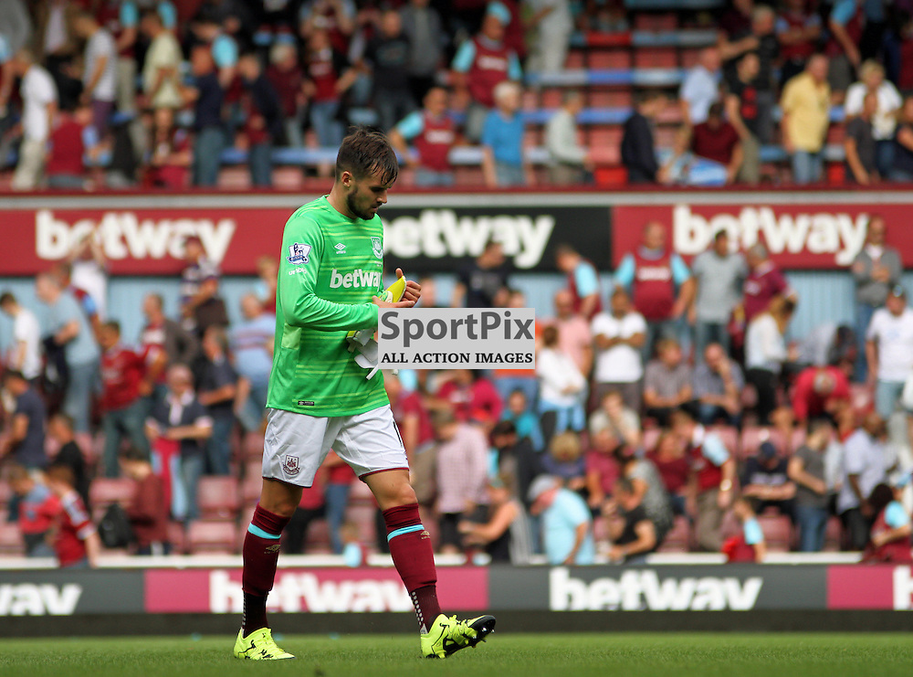 Carl Jenkinson looks dejected after West Ham United's loss when he had to deputise the final minutes for Adrian in goal During West Ham United vs Leicester City on Saturday the 16th August 2015.